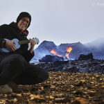 me playing ukulele in front of volcano